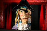 The evil pirate Eddie Snickerbucket gazes at the audience. Photo by Yoshi Hosaka.